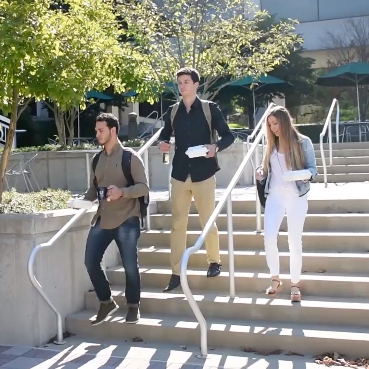 College students walking down steps